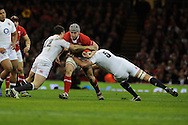 Jonathan Davies of Wales is tackled by England's Brad Barritt (12)  and Owen Farrell. RBS Six nations championship 2013, Wales v England at the Millennium stadium in Cardiff , South Wales on Saturday 16th March 2013. pic by Andrew Orchard, Andrew Orchard sports photography,