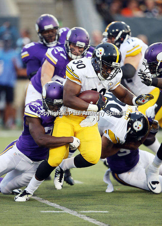 Pittsburgh Steelers rookie running back Cameron Stingily (30) is tackled by Minnesota Vikings cornerback Xavier Rhodes (29) as he runs the ball in the first quarter during the 2015 NFL Pro Football Hall of Fame preseason football game against the Minnesota Vikings on Sunday, Aug. 9, 2015 in Canton, Ohio. The Vikings won the game 14-3. (©Paul Anthony Spinelli)