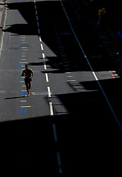 © Licensed to London News Pictures. 21/04/2013. London, UK. A competitor runs near Southwark Bridge during the Virgin London Marathon 2013 on April 21, 2013 in London, England.Photo credit : Peter Kollanyi/LNP