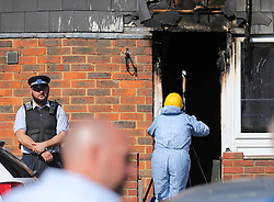 "© Licensed to London News Pictures. 07/08/2018. London, UK. Police and an investigation team at the scene of a house fire in Deptford, east London, in which a 7 year-old boy has died. Six fire engines were called to a ""suspicious"" fire in the early hours of Tuesday morning. Photo credit: Rob Pinney/LNP"