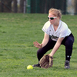Staff photos by Tom Kelly IV<br /> Ridley centerfielder M. Malseed (1) fields a ground ball during the Ridley at Upper Darby softball game on Wednesday.