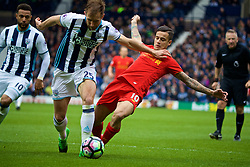 WEST BROMWICH, ENGLAND - Easter Sunday, April 16, 2017, 2016: Liverpool's Philippe Coutinho Correia is pushed over by West Bromwich Albion's Craig Dawson but the referee refuses to award a penalty during the FA Premier League match at the Hawthorns. (Pic by David Rawcliffe/Propaganda)
