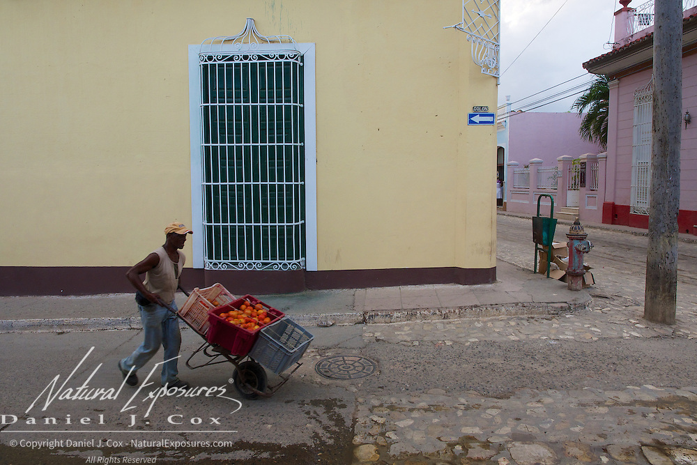 A man selling tomatoes on the streets of Trinidad, Cuba
