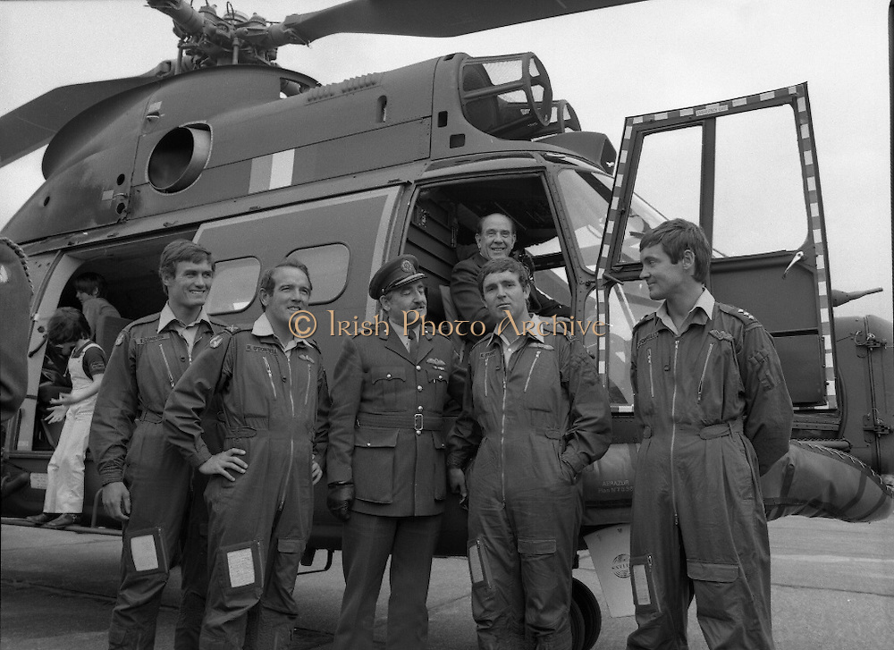"Air Corps Takes Delivery Of Puma Helicoptor. (N86)..1981..22.07.1981..07.22.1981..22nd July 1981..The Air Corps took delivery,today, of a new French Built SA 330 J ""Puma"" Helicoptor. The ""Puma"" escorted by another Air Corps helicoptor landed at Casement Aerodrome, Baldonnell,Co Dublin...Image of the helicoptor crew, Brig General William Glenn and the Minister, James Tully TD as they pose by the new ""Puma"" helicoptor."