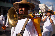 A band plays in the morning procession during the Phuket Vegetarian Festival, Phuket, Thailand.