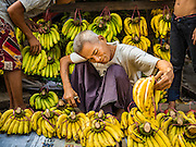 "25 OCTOBER 2015 - INSEIN, MYANMAR:  Selling bananas at Danyin Market (also known as Da Nyin) in Insein, Myanmar, about 90 minutes from Yangon. Vendors in the market sell just about everything people in the area need, but mostly it's a ""wet market"" with fruits, vegetables and meats. Most people in Myanmar still do not have refrigerators in their homes, so people go to market almost every day.    PHOTO BY JACK KURTZ"