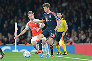 Bayern Munich striker Thomas Muller plays the ball away from Arsenal defender Nacho Monreal during the Champions League  Group F match between Arsenal and Bayern Munich at the Emirates Stadium, London, England on 20 October 2015. Photo by Alan Franklin.