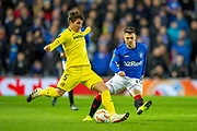 Santiago Caseres (#5) of Villarreal CF clears the ball from Glenn Middleton (#40) of Rangers FC during the Europa League group stage match between Rangers FC and Villareal CF at Ibrox, Glasgow, Scotland on 29 November 2018.