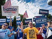 04 JULY 2019 - SLATER, IOWA: Supporters of Senator Bernie Sanders (Ind-VT) wait for the 4th of July parade in Slater, IA, to start. Sen. Sanders marched in the 4th of July parade in Slater to support his bid to be the Democratic nominee for the US presidency in 2020. Iowa holds the first presidential selection event of the 2020 election cycle. The Iowa caucuses are on Feb. 3, 2020.          PHOTO BY JACK KURTZ