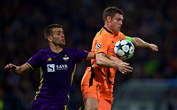 MARIBOR, SLOVENIA - Tuesday, October 17, 2017: Liverpool's James Milner and NK Maribor's Mitja Viler during the UEFA Champions League Group E match between NK Maribor and Liverpool at the Stadion Ljudski vrt. (Pic by David Rawcliffe/Propaganda)