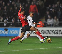Swansea City's Wayne Routledge shoots at goal. - Photo mandatory by-line: Alex James/JMP - Tel: Mobile: 07966 386802 08/02/2014 - SPORT - FOOTBALL - Swansea - Liberty Stadium - Swansea City v Cardiff City - Barclays Premier League