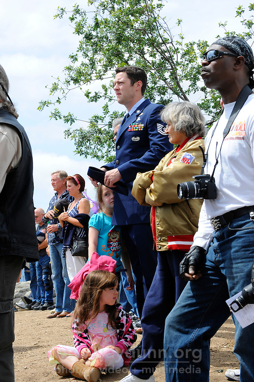 Members of the public watch Monday's somber Memorial Day remembrances at the Monterey County Vietnam Veterans Memorial in Salinas.