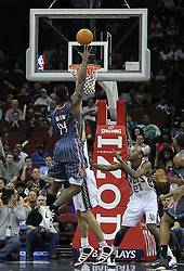 Apr 11; Newark, NJ, USA; Charlotte Bobcats center Kwame Brown (54) hits a shot over New Jersey Nets center Brook Lopez (11) during the first half at the Prudential Center.