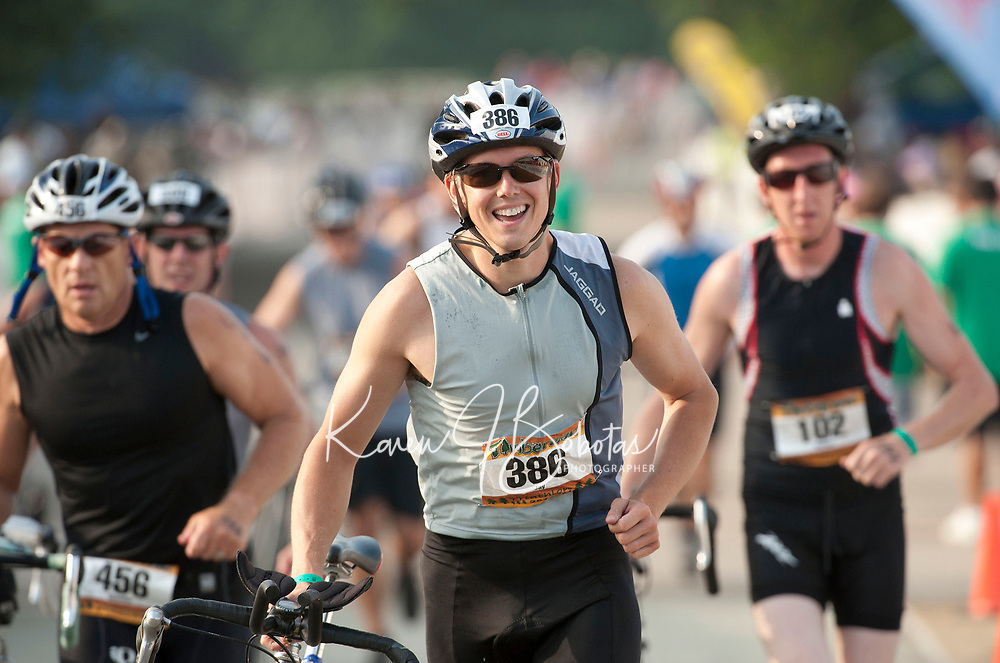 Past competitors during the bike leg of the Timberman Sprint at Ellacoya State Park in Gilford, NH. (Karen Bobotas/for the Laconia Daily Sun)