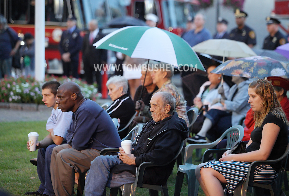 Middletown, New York - People listen to a speaker during the Middletown Fire Department 9/11 Memorial Service at Festival Square on Sept. 11, 2011.