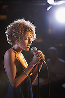 Jazz singer on stage profile
