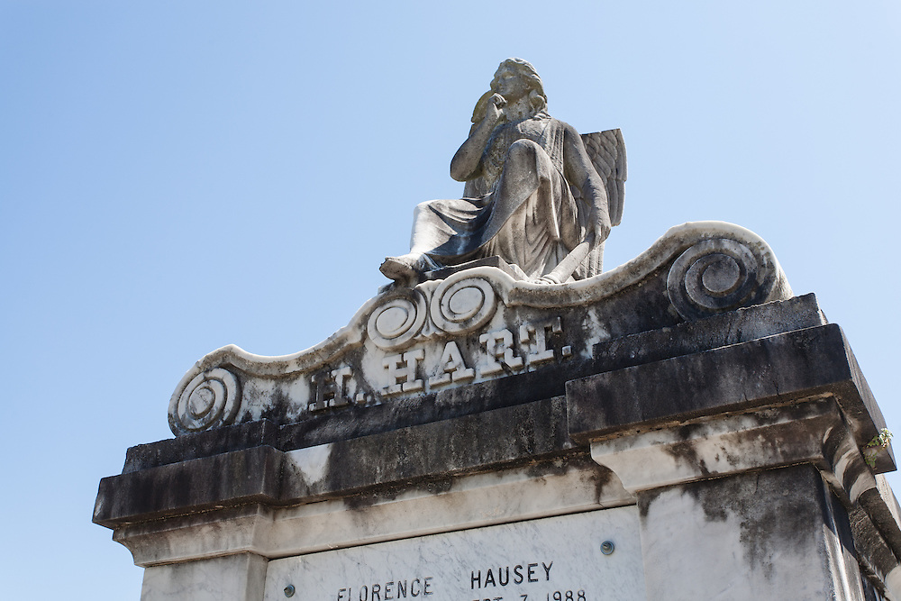 A beautiful sculpture on top of a tomb at the Lafayette Cemetery No. 1, Garden District, New Orleans, Louisiana