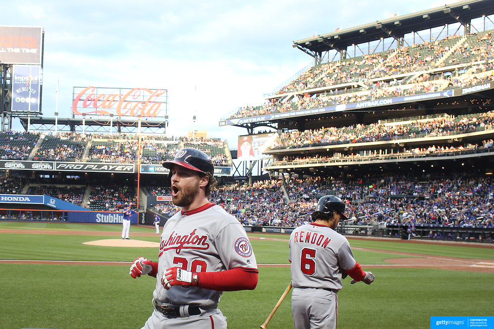 NEW YORK, NEW YORK - May 19: Daniel Murphy #20 of the Washington Nationals celebrates as he returns to the dugout after hitting a two run home run off Matt Harvey #33 of the New York Mets in the first inning during the Washington Nationals Vs New York Mets regular season MLB game at Citi Field on May 19 2016 in New York City. (Photo by Tim Clayton/Corbis via Getty Images)