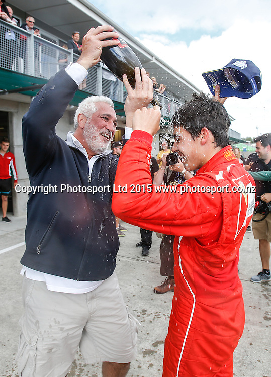 Lance Stroll (R) celebrates with his father Lawrence after winning the New Zealand Grand Prix -Toyota Racing Series, Manfeild Motorsport Park, Feidling, New Zealand. Sunday, 15 February, 2015. Photo: John Cowpland / www.photosport.co.nz