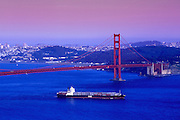 Image of the Golden Gate Bridge with freighter in San Francisco Bay, California