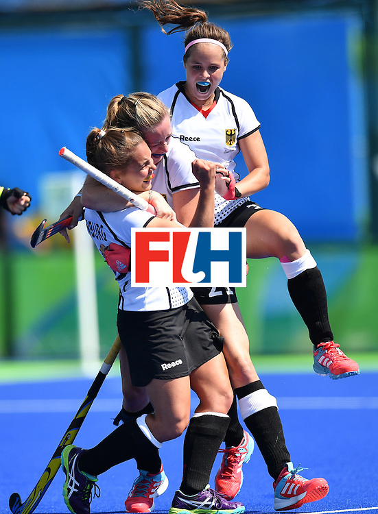 Germany's Lisa Altenburg (L) celebrates a goal with teammates during the women's quarterfinal field hockey USA vs Germany match of the Rio 2016 Olympics Games at the Olympic Hockey Centre in Rio de Janeiro on August 15, 2016. / AFP / MANAN VATSYAYANA        (Photo credit should read MANAN VATSYAYANA/AFP/Getty Images)