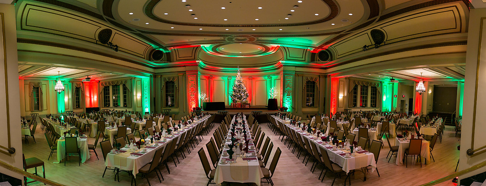 """Tables are set and the Christmas Tree is lit fir the 84th Annual Tudor Holiday Dinner and Concert. The event returned to Memorial Union from November 23-December 3, 2017.  Tudor Dinners presents fine dining, old English pageantry, and choral presentations by the Philharmonic Chorus of Madison, with a new twist.  The program consists of wassail bowl and hors d'oeuvres, presentation of the Boar's Head, the Grand Processional and caroling, the Banquet Ceremonial and dinner, strolling minstrels, Figgy Pudding Ceremonial and a Yuletide Toast.  A Celebration of Song by the Philharmonic Chorus of Madison and carols for singing by all proceeds throughout the evening.  This annual event is a """"must do"""" for everyone that loves the Wisconsin Union."""
