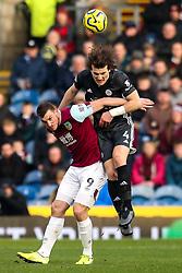 Caglar Soyuncu of Leicester City beats Chris Wood of Burnley to a header - Mandatory by-line: Robbie Stephenson/JMP - 19/01/2020 - FOOTBALL - Turf Moor - Burnley, England - Burnley v Leicester City - Premier League