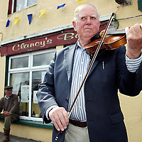 Vincent Griffin from Feakle warms up his fiddle before starting his workshop during the Nell Galvin music festival in Moyasta at the weekend.<br />