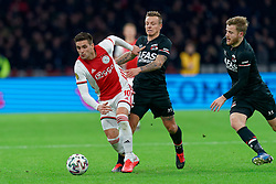 Dusan Tadic #10 of Ajax and Jordy Clasie #20 of AZ Alkmaar in action during the Dutch Eredivisie match round 25 between Ajax Amsterdam and AZ Alkmaar at the Johan Cruijff Arena on March 01, 2020 in Amsterdam, Netherlands