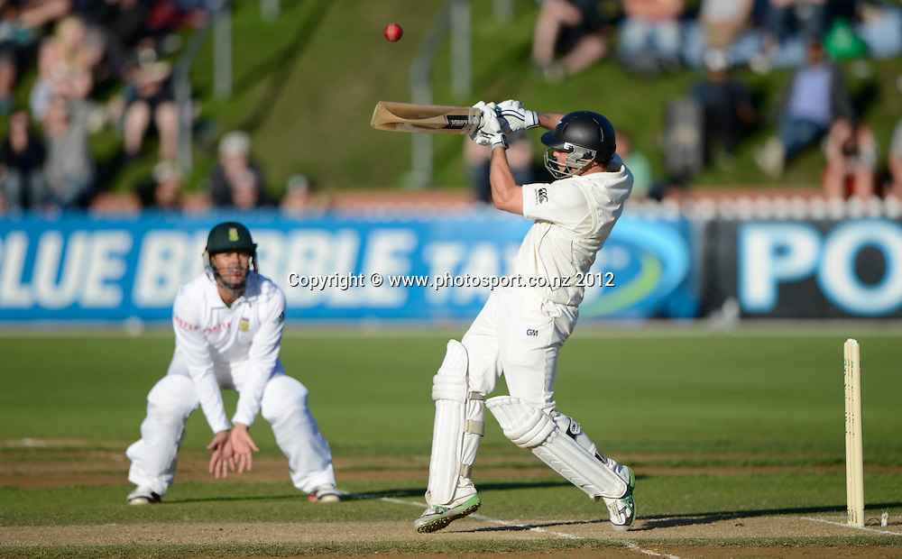 New Zealand opening batsman Daniel Flynn batting as Jacques Rudolph looks on. Third Test, Day 3. New Zealand Black Caps versus South Africa Proteas, Basin Reserve, Wellington, New Zealand. Sunday 25 March 2012. Photo: Andrew Cornaga/Photosport.co.nz
