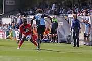 David Tutonda takes one for the club from Sido Jombati's clearance during the Sky Bet League 2 match between Wycombe Wanderers and York City at Adams Park, High Wycombe, England on 8 August 2015. Photo by Simon Davies.