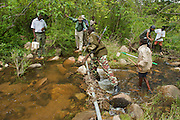 Crossing the stream on a hike to the source for testing.