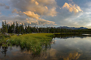 The colors of sunset are reflected in Old Crow Lake in the Cloud Peak Wilderness.