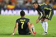 Cristiano Ronaldo of Juventus FC is conforted by Frederico Bernardeschi after receiving a red card during the UEFA Champions League, Group H football match between Valencia CF and Juventus FC on September 19, 2018 at Mestalla stadium in Valencia, Spain - Photo Manuel Blondeau / AOP Press / ProSportsImages / DPPI