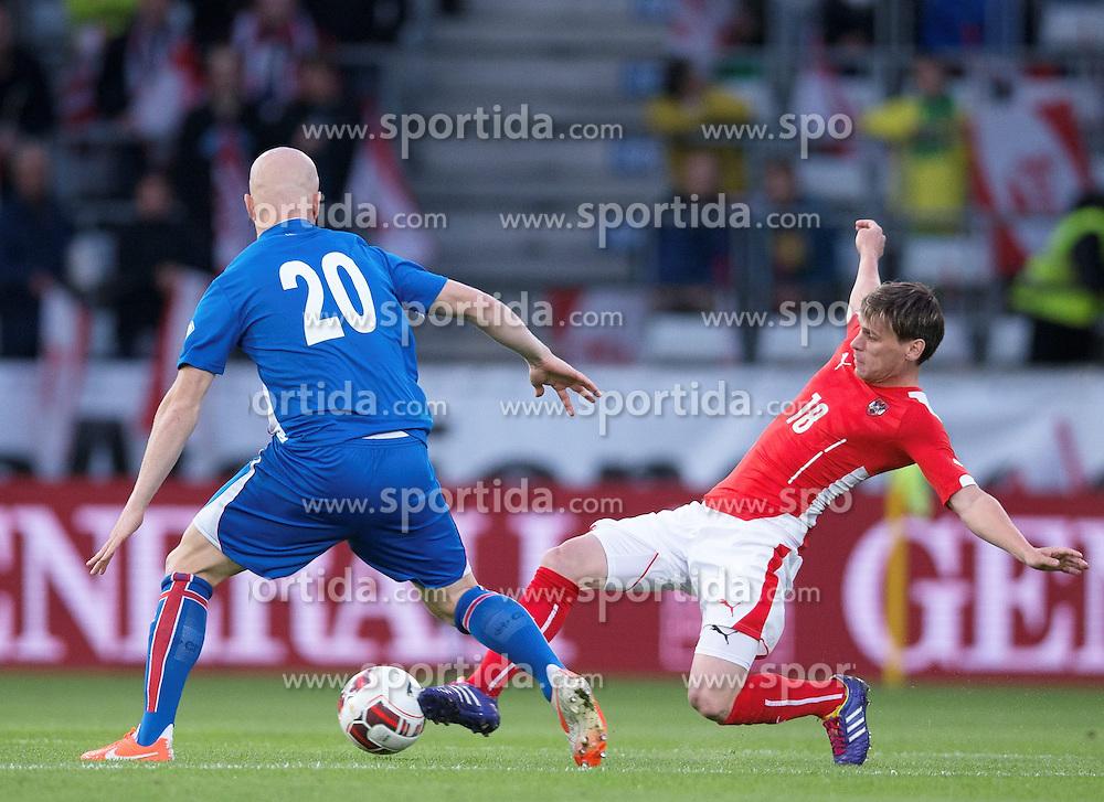 30.05.2014, Tivoli Stadion, Innsbruck, AUT, Fussball Testspiel, Oesterreich vs Island, im Bild (v.l.) Emil Hallfredsson (ISL), Christoph Leitgeb (AUT) // Emil Hallfredsson (ISL) (L) in action against Elmar Bjarnason (ISL) during the International Friendly between Austria and Iceland at the Tivoli Stadion in Innsbruck, Austria on 2014/05/30. EXPA Pictures © 2014, PhotoCredit: EXPA/ Johann Groder