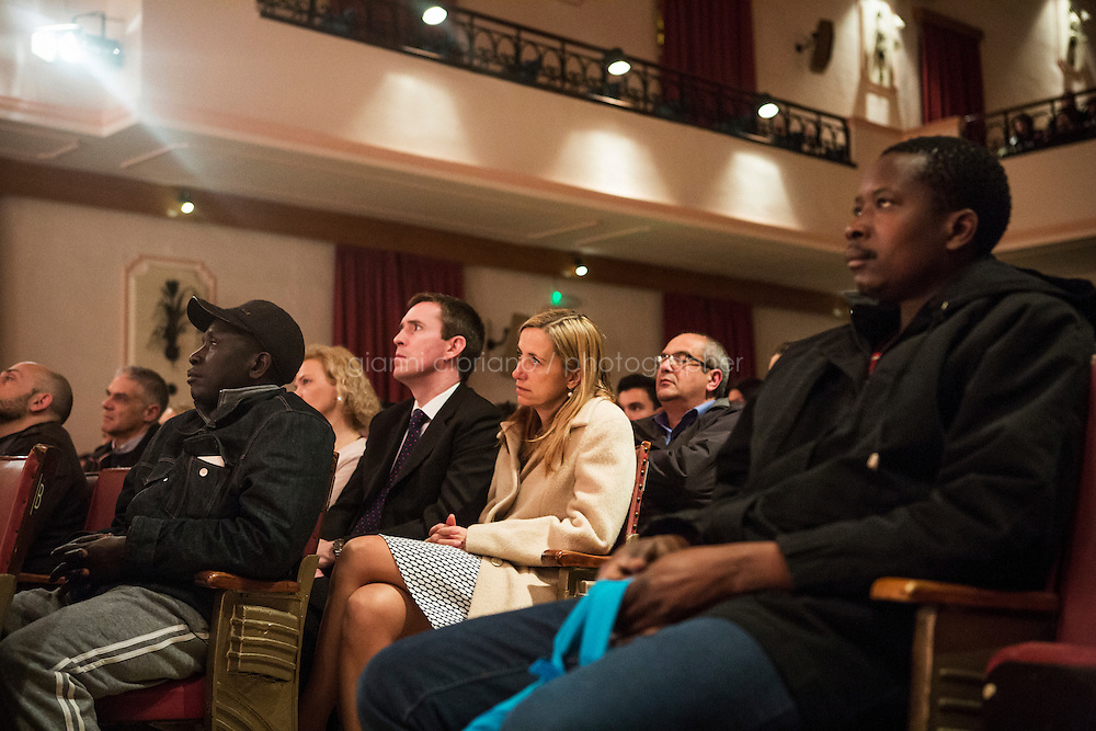 SLIEMA, MALTA - 8 FEBRUARY 2016: Sub-Saharan migrants from the Hal Far camp watch the touring Hamlet, performed by the Shakespeare's Globe theatre company, among the Maltese audience at the Salesian Theatre in Sliema, Malta, on February 8th 2016.<br /> <br /> The touring Hamlet, performed by the Shakespeare's Globe theatre company, is part of the Globe to Globe tour that set off in April 2014 (on the 450th anniversary of Shakespeare's birth) with the ambitious intention of visiting every country in the world over 2 years. The crew is composed of a total of sixteen men and women: four stage managers and twelve twelve actors  actors perform over two dozen parts on a stripped-down wooden stage. So far Hamlet has been performed in over 150 countries, to more than 100,000 people and travelled over 150,000 miles. The tour was granted UNESCO patronage for its engagement with local communities and its promotion of cultural education. Hamlet was also played for many dsiplaced people around the world. It was performed in the Zaatari camp on the border between Syria and Jordan, for Central African Republic refugees in Cameroon, and for Yemeni people in Djibouti. On February 3rd it was performed to about 300 refugees in Calais at the camp known as the Jungle.