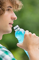 Close-up of man drinking energy drink outdoors