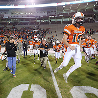 Adam Robison   BUY AT PHOTOS.DJOURNAL.COM<br /> Calhoun City's Mcgreger Lee jumps in celebration as he storms the feild with his teams after winning the MHSAA Class 2A Football State Chanpionship after Calhoun City defeated Bay Springs 22-8 Friday in Strakville.