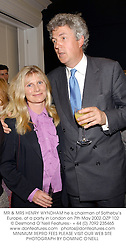 MR & MRS HENRY WYNDHAM he is chairman of Sotheby's Europe, at a party in London on 7th May 2002.	OZP 102