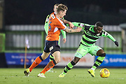 Forest Green Rovers Drissa Traoré(4) holds off Luton Town's Glen Rea during the EFL Sky Bet League 2 match between Forest Green Rovers and Luton Town at the New Lawn, Forest Green, United Kingdom on 16 December 2017. Photo by Shane Healey.