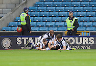 Lee Gregory (middle on ground) of Millwall celebrates after scoring with his team mates to make it 4-1 on aggregate during the Sky Bet League 1 Playoff Semi-final Leg Two at The Den, London<br /> Picture by Alan Stanford/Focus Images Ltd +44 7915 056117<br /> 20/05/2016