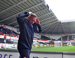 Cardiff City's Craig Bellamy does the Ayatollah at he arrivals at the  Liberty Stadium - Photo mandatory by-line: Alex James/JMP - Tel: Mobile: 07966 386802 08/02/2014 - SPORT - FOOTBALL - Swansea - Liberty Stadium - Swansea City v Cardiff City - Barclays Premier League