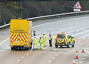 &copy; Licensed to London News Pictures. 14/11/2014. Leatherhead, UK M25 section in Surrey collapses following roadworks<br /> M25. The pothole appeared on the M25 in the early hours of 14th November 2014. Three lanes of the M25 in Surrey have been closed after a section collapsed and left a large pothole, following overnight roadworks. Surrey Police said many vehicles had been left with damaged tyres after the road surface near Leatherhead fell in during heavy rain at about 05:30 GMT.. Photo credit : Stephen Simpson/LNP