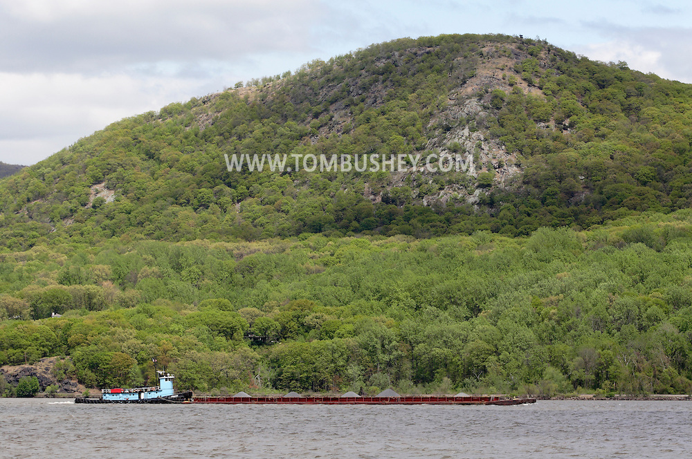 Cornwall-on-Hudson, New York - The tugboat Cheyenne pushes a barge down the Hudson River on April 27, 2010.