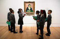 © Licensed to London News Pictures. 25/03/2019. Schoolchildren from Milbank Primary Academy view a painting titled The Arlesienne (1890) by artist Vincent van Gogh. The painting is part of The EY Exhibition: Van Gogh and Britain at the Tate BritainLondon, UK. Photo credit: Ray Tang/LNP