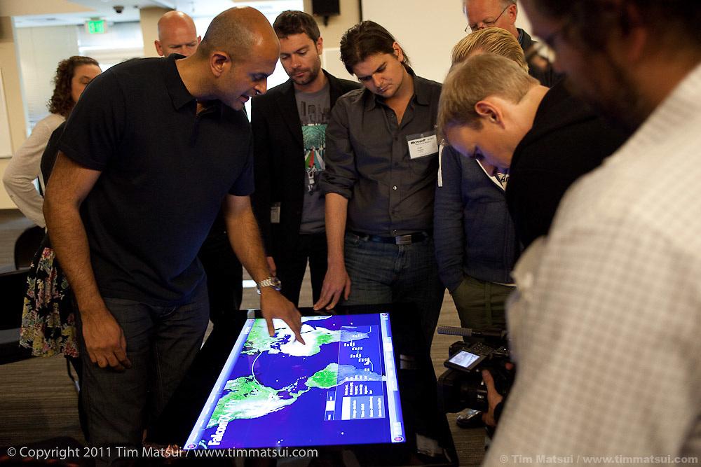 Somanna Palacanda, Director, U.S. Hardware, demonstrates Microsoft's new Surface technology at the Microsoft Campus in Redmond, Washington, USA, on Wednesday, June 8, 2011. Photo by Tim Matsui / Microsoft.