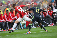 Manchester United's Marnick Vermijl against Ajax Cape Town's Paul Rusike during their International friendly match at Cape Town Stadium