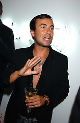 Fashion designer JULIEN MACDONALD at the launch of 'Blow Lips' a new lipstick by Isabella Blow and MAC Makeup held at the the Blow de la Barra Gallery, 35 Heddon Street, London on 7th September 2005.<br /><br />NON EXCLUSIVE - WORLD RIGHTS