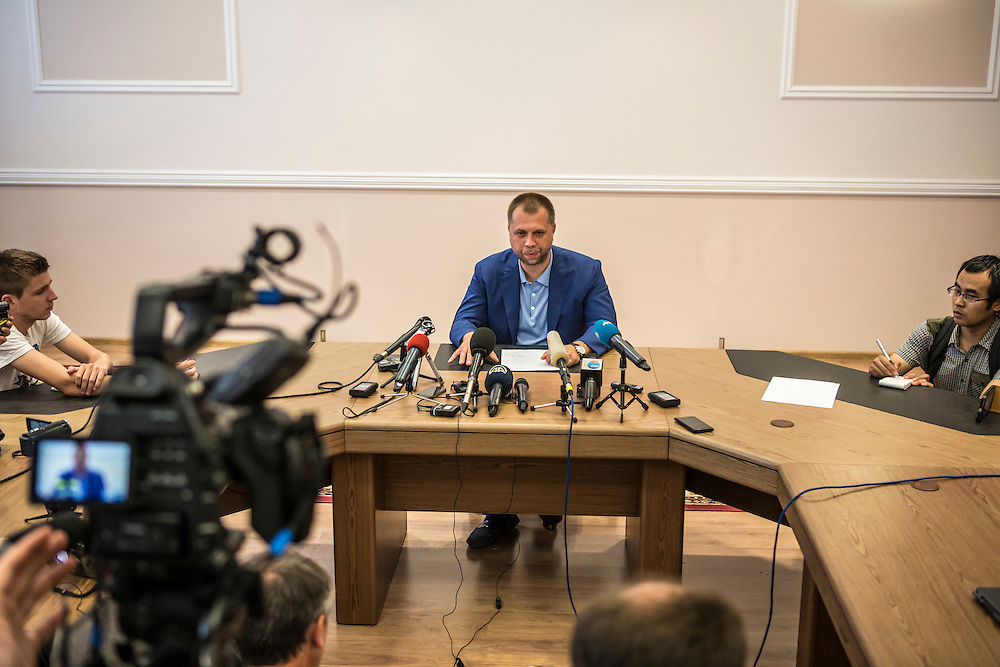 DONETSK, UKRAINE - JULY 19: Alexander Borodai, Prime Minister of the self-proclaimed Donetsk People's Republic, speaks at a news regarding the crash of Malaysia Airlines flight MH 17 on July 19, 2014 in Donetsk, Ukraine. Malaysia Airlines flight MH17 was travelling from Amsterdam to Kuala Lumpur when it crashed killing all 298 on board including 80 children. The aircraft was allegedly shot down by a missile and investigations continue over the perpetrators of the attack. (Photo by Brendan Hoffman/Getty Images) *** Local Caption ***