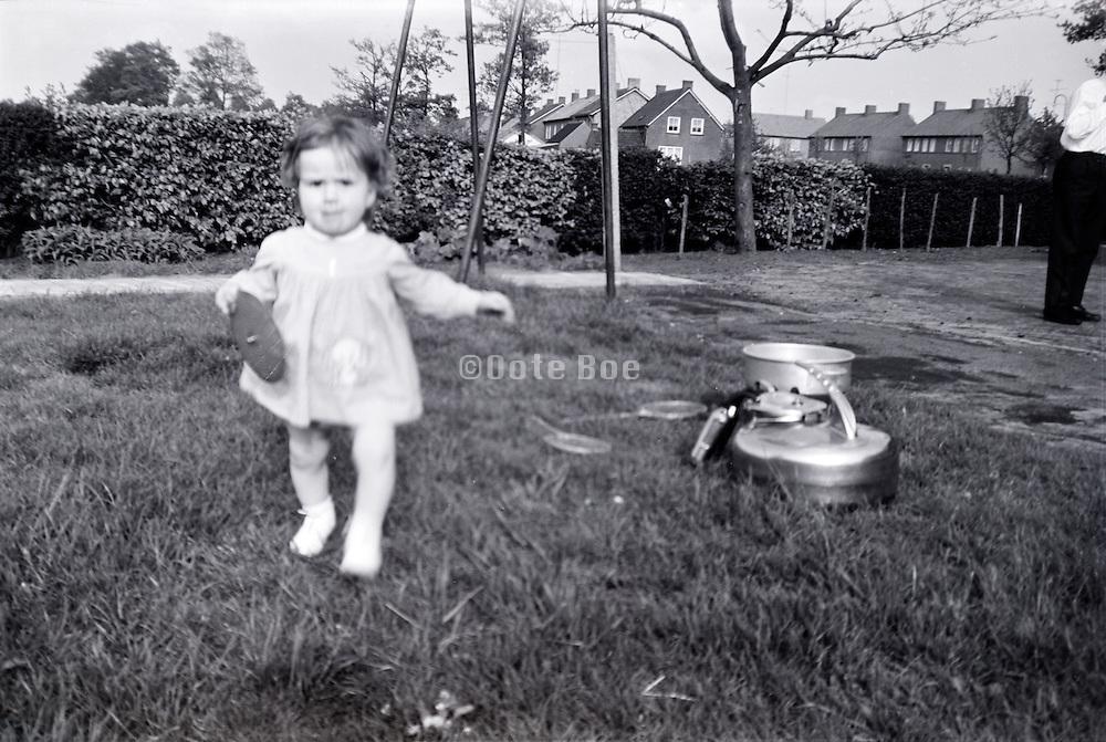 little girl near an milking machine can Holland 1960s